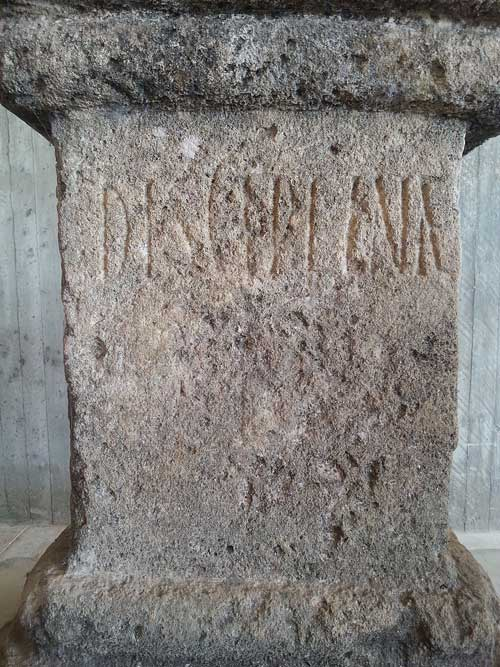 ancient stone marker with disciplinae chiselled on it